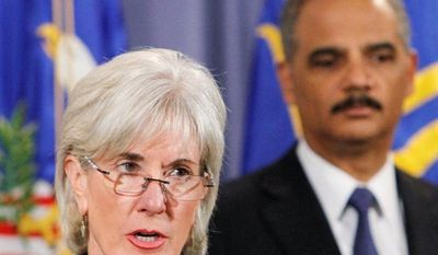** FILE ** Health and Human Services Secretary Kathleen Sebelius speaks about the law enforcement actions of the Medicare Fraud Strike Force as Attorney General Eric H. Holder Jr. listens at the Justice Department on Wednesday, Oct. 3, 2012. (Associated Press)