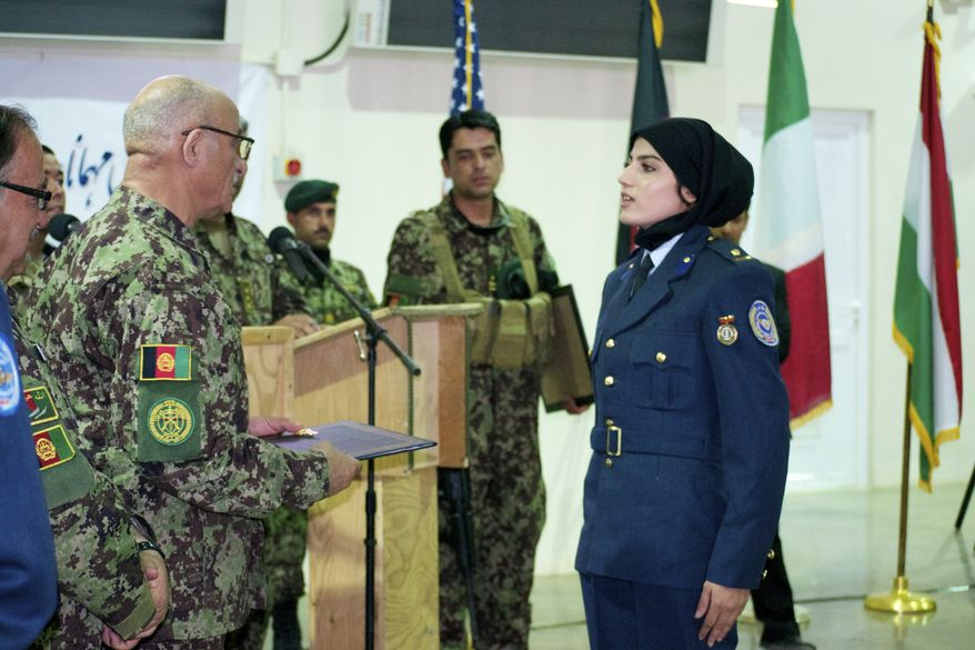 2nd Lt. Niloofar Rhmani is the first female pilot to be trained in Afghanistan in 30 years. She earned her wings this week at a graduation ceremony at Shindand Air Base, and will go on to fly Cessna 208s. (Credit: Kristina Wong/The Washington Times)