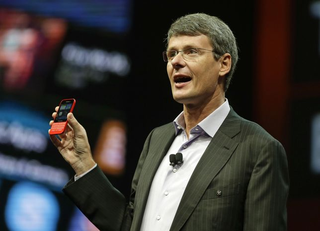Thorsten Heins, president and CEO of Research In Motion, holds up the new BlackBerry 10 mobile device at the company's annual conference on Tuesday, May 14, 2013, in Orlando, Fla. (AP Photo/John Raoux)
