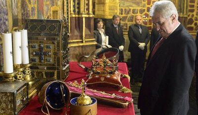 Czech President Milos Zeman views the Czech crown jewels on Thursday, May 9, 2013, before their ceremonial transfer from the crown jewels chamber in St. Vitus Cathedral to the Vladislav Hall at the Prague Castle for a rare public showing. (AP Photo/CTK, Michal Kamaryt)