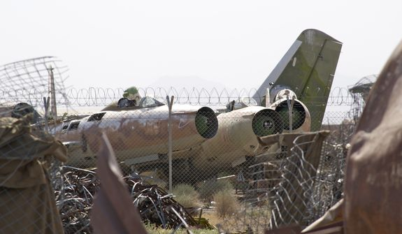 "Known as the ""Shindand boneyard,"" scraps of Soviet aircraft from the 1980s litter the landscape at Shindand Air Base, an Afghan military base in the westernmost province of Herat. (Kristina Wong/The Washington Times)"