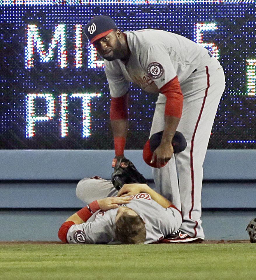 Washington Nationals outfielder Bryce Harper left Monday night's game in the fifth inning after a gruesome collision with the right field scoreboard at Dodger Stadium as he attempted to catch a fly ball. (Associated Press photo)
