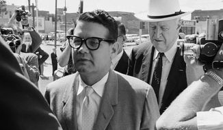 Billie Sol Estes (left) and his attorney, John Cofer of Austin, Texas, arrive at the federal courthouse in El Paso, Texas, on May 23, 1962. (AP Photo/Ferd Kaufman)