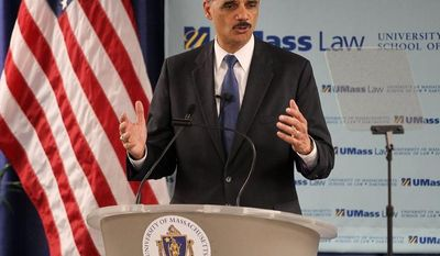 **FILE** U.S. Attorney General Eric Holder delivers an address at the University of Massachusetts School of Law in Dartmouth, Mass., on March 1, 2013. (Associated Press)