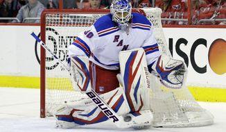 New York Rangers goalie Henrik Lundqvist (30), from Sweden, blocks a shot during, Game 7 first-round NHL Stanley Cup playoff hockey series against the Washington Capitals, Monday, May 13, 2013 in Washington. (AP Photo/Alex Brandon)