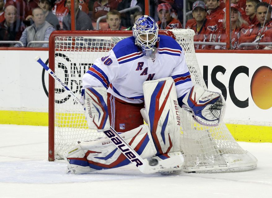 New York Rangers goalie Henrik Lundqvist (30), from Sweden, blocks a shot during, Game 7 first-round NHL Stanley Cup playoff hockey series against the Washington Capitals, Monday, May 13, 2013 in Washington. (AP Photo/Alex Brandon)