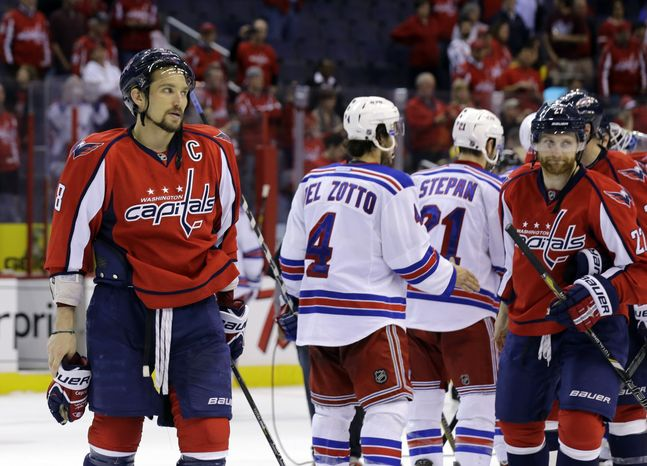 Washington Capitals left wing Alex Ovechkin (8), from Russia, pauses after Game 7 first-round NHL Stanley Cup playoff hockey series against the New York Rangers, Monday, May 13, 2013 in Washington. The Rangers won 5-0. (AP Photo/Alex Brandon)