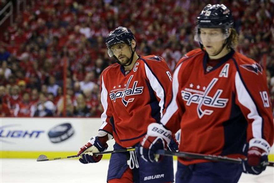 Washington Capitals left wing Alex Ovechkin (8), from Russia, and center Nicklas Backstrom (19), from Sweden, skate during a break in the action, in the first period of Game 5 first-round NHL Stanley Cup playoff hockey series against the New York Rangers, Friday, May 10, 2013 in Washington. (AP Photo/Alex Brandon)