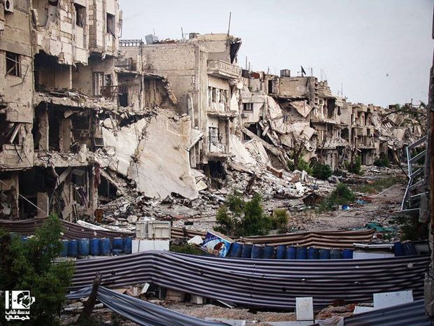 This citizen journalism image provided by Lens Young Homsi, which has been authenticated based on its contents and other AP reporting, shows buildings which were destroyed from Syrian forces shelling, in Homs province, Syria, Tuesday, May 14, 2013. (AP Photo/Lens Young Homsi)