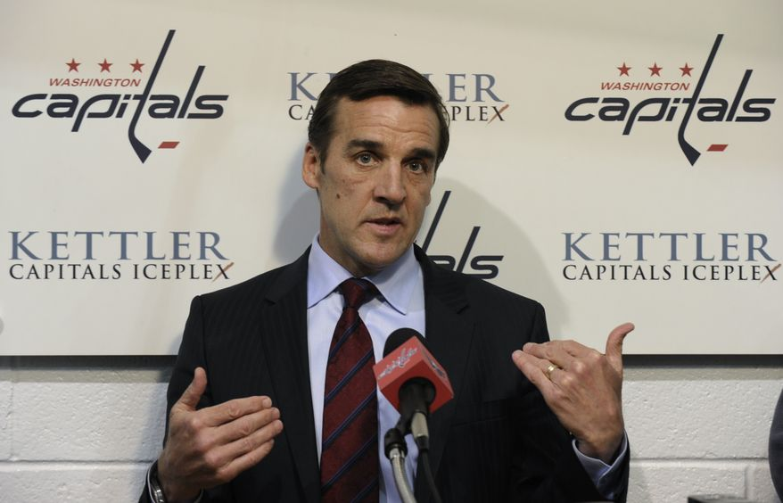 Washington Capitals general manager George McPhee talks with reporters at the Kettler Iceplex in Arlington, Va., Wednesday, May 15, 2013. The Capitals were eliminated in the first round of the NHL Stanley Cup playoffs by the New York Rangers. The Capitals have had six consecutive playoff appearances and have failed to get past the second round. (AP Photo/Susan Walsh)