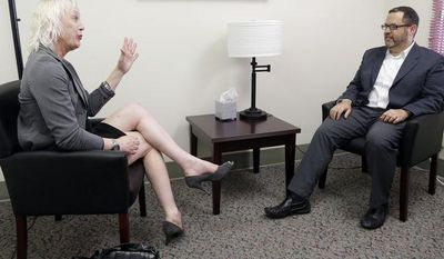 Rachel Sorrow (left), a transgender woman, attends a therapy session with Dr. Dan Karasic, a psychiatrist with the Center of Excellence for Transgender Health at San Francisco General Hospital in San Francisco on July 20, 2012. (Associated Press)