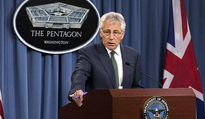 ** FILE ** Secretary of Defense Chuck Hagel answers questions on Syria during a joint news conference with the United Kingdom's Secretary of State for Defence Phillip Hammond, at the Pentagon in Washington, Thursday, May 2, 2013. (AP Photo/J. Scott Applewhite)
