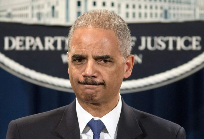 ** FILE ** Attorney General Eric Holder is questioned about the Justice Department secretly obtaining two months of telephone records of reporters and editors for The Associated Press, during a news conference at the Justice Department in Washington, Tuesday, May 14, 2013. (AP Photo/J. Scott Applewhite)