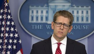White House spokesman Jay Carney listens to a question during his daily news briefing at the White House in Washington on May 15, 2013. (Associated Press)