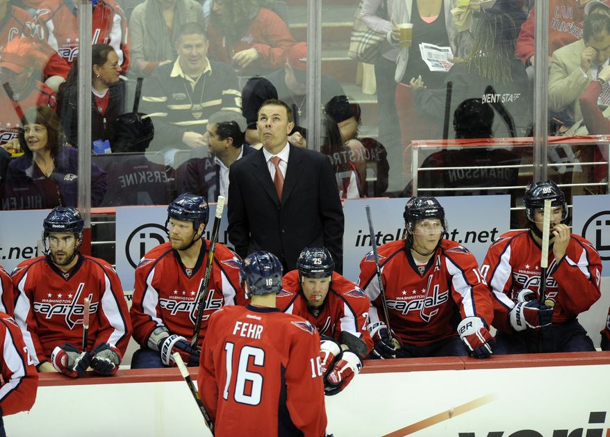 Washington Capitals head coach Adam Oates, center, looks on during the second period of Game 7 first-round NHL Stanley Cup playoff hockey series against the New York Rangers, Monday, May 13, 2013, in Washington. (AP Photo/Nick Wass)
