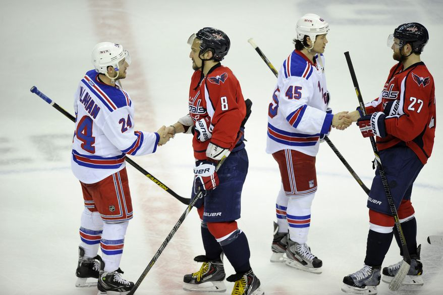 Washington Capitals left wing Alex Ovechkin (8), from Russia, and Karl Alzner (27) shakes hands with New York Rangers right wing Ryan Callahan (24) and Arron Asham (45) after a Game 7 first-round NHL Stanley Cup playoff hockey series, Monday, May 13, 2013, in Washington. The Rangers won 5-0. (AP Photo/Nick Wass)