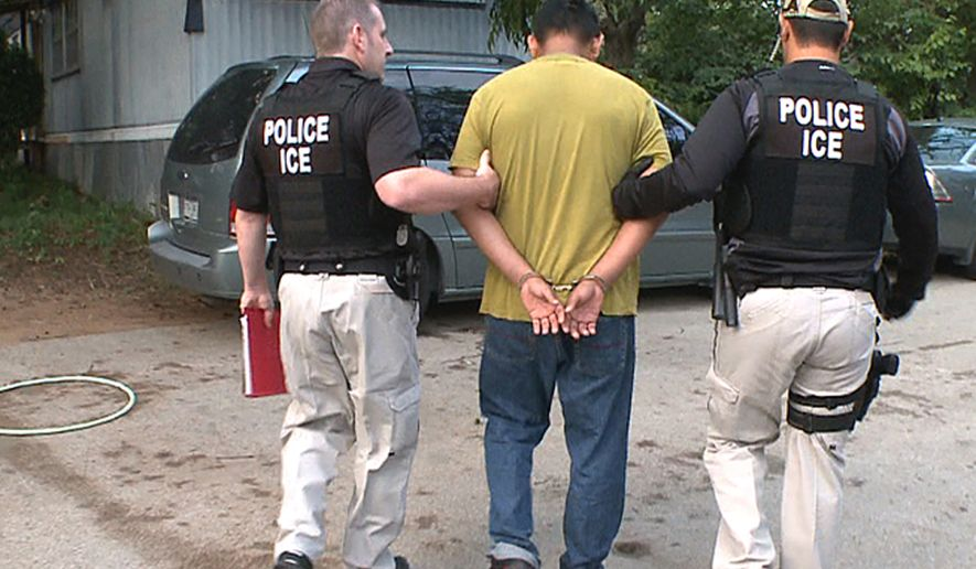 **FILE** In this photo proved by U.S. Immigration and Customs Enforcement, an unidentified immigrant is taken into custody in Dallas on Sept. 8, 2012. (Associated Press/ICE)