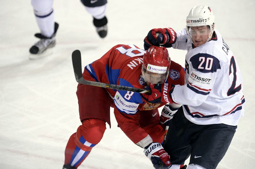 Russia's Alexander Ovechkin, left, competes with Ryan Carter of team USA during the 2013 Ice Hockey IIHF World Championships Group B Quarterfinal match Russia vs USA in Helsinki, Finland on Thursday May 16, 2013. (AP Photo/LEHTIKUVA / Martti Kainulainen)