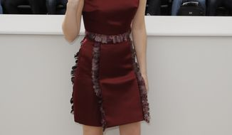 """British actress Emma Watson poses for photographers during a photo call for the film """"The Bling Ring"""" at the 66th Cannes Film Festival in Cannes, France, on Thursday, May 16, 2013. (AP Photo/Francois Mori)"""