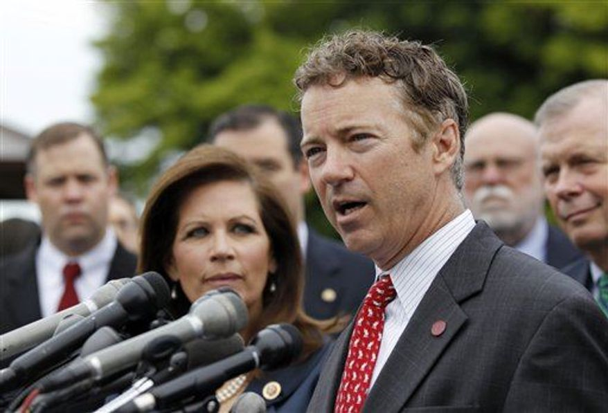 Rep. Michele Bachmann, R-Minn., chairwoman of the Tea Party Caucus, listens at left as while Sen. Rand Paul, R-Ky., speaks during a news conference with Tea Party leaders about the IRS targeting Tea Party groups, Thursday, May 16, 2013, on Capitol Hill in Washington. (Associated Press)