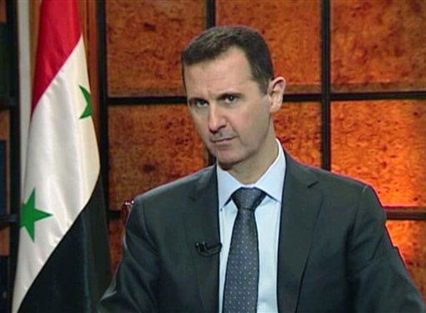 ** FILE ** Syrian President Bashar Assad speaks during an interview on Wednesday, April 17, 2013. (Associated Press/Syrian State TV via AP video)