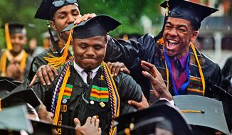 Graduating senior Leland Shelton is congratulated during Morehouse College 2013 commencement exercises.  (Associated Press)