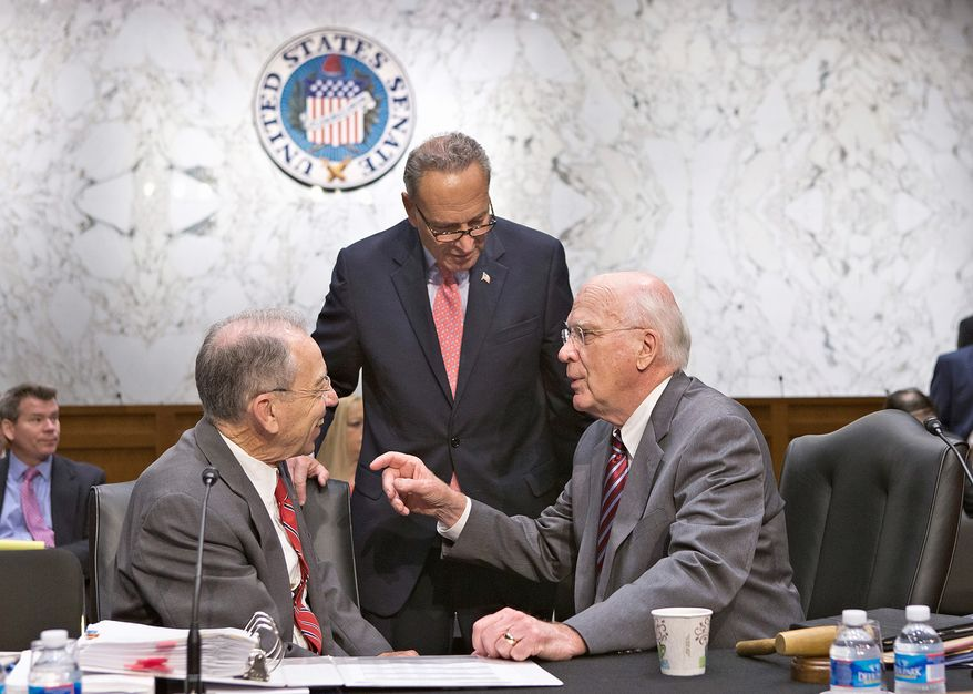 Senate Judiciary Committee members (from left) Chuck Grassley, Iowa Republican, Charles E. Schumer, New York Democrat, and Patrick J. Leahy, Vermont Democrat, confer Monday on the landmark immigration bill. (Associated Press)