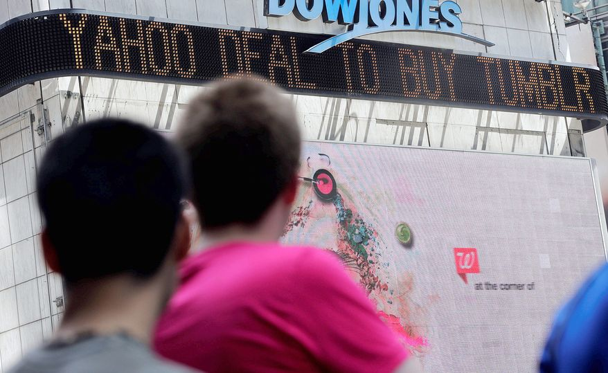 News of Tumblr's sale to Yahoo Inc. scrolls on a Times Square ticker in New York City on Monday. Yahoo announced it will purchase Tumblr for about $1.1 billion and pledged to take a hands-off approach to the popular social media startup. (Associated Press)