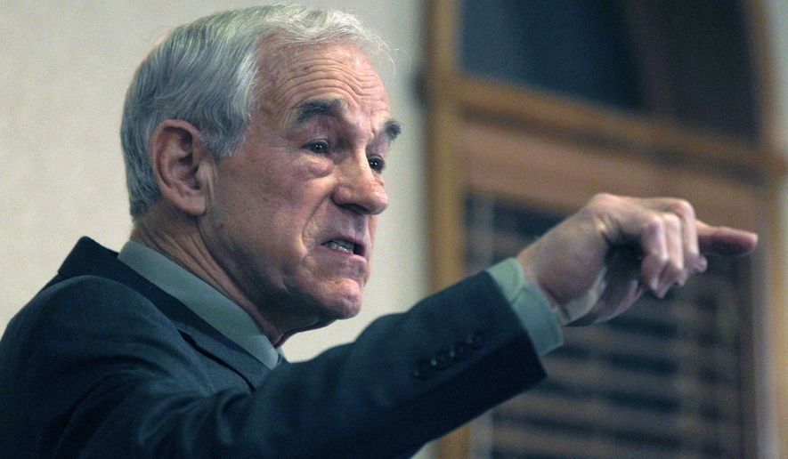 ** FILE ** Then-Rep. Ron Paul, Texas Republican, speaks during a campaign stop in Manchester, N.H., on Dec. 19, 2011, during his bid for the party's presidential nomination. (Associated Press)