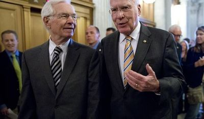 **FILE** Sens. Patrick Leahy (right), Vermont Democrat and president pro tempore of the Senate, and Thad Cochran, Mississippi Republican, walk to the floor of the Senate on Capitol Hill on May 6, 2013, during a vote on legislation to collect sales tax on Internet purchases. (Associated Press)