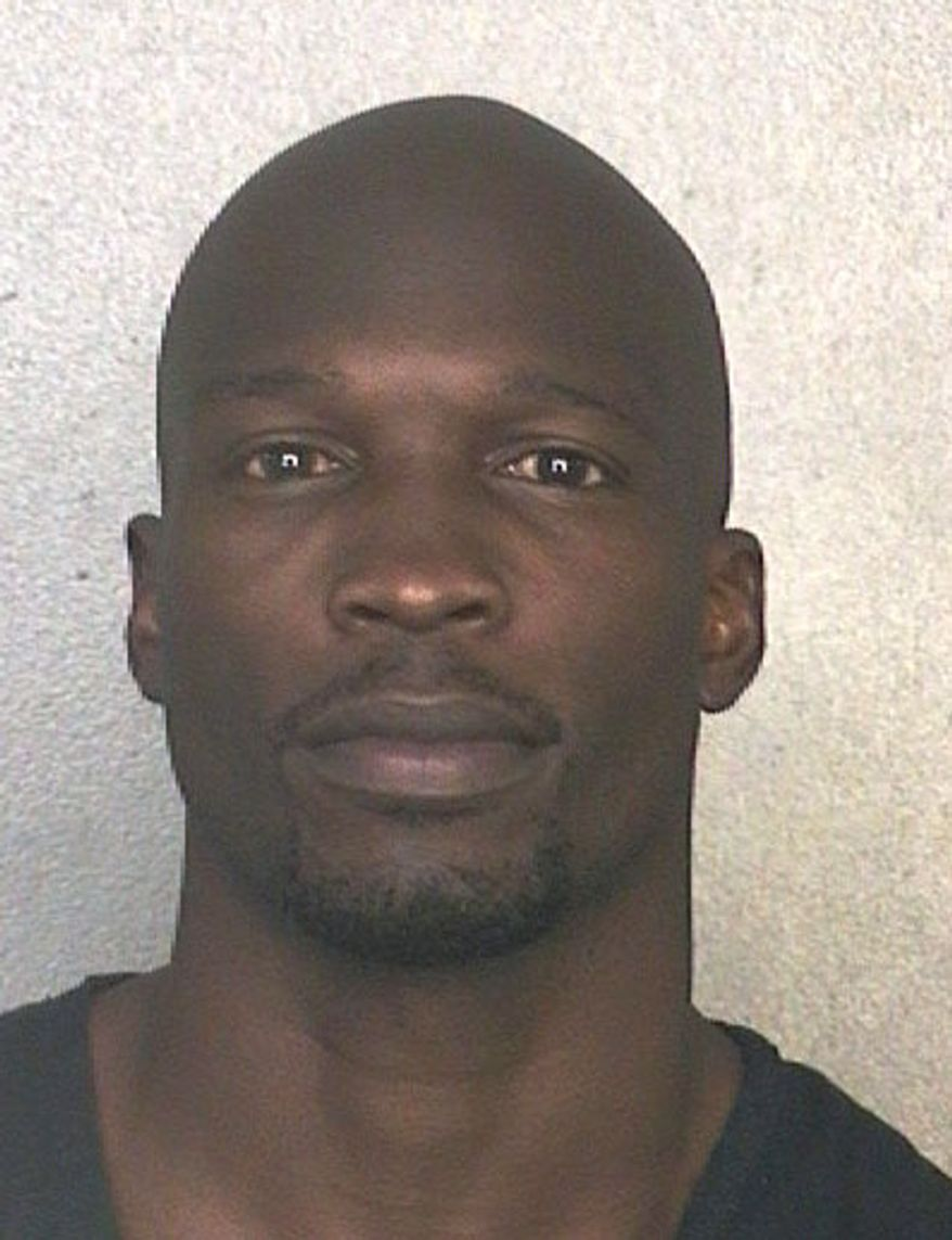 This arrest photo made available May 20, 2013, by the Broward County Sheriff's Office shows former NFL wide receiver Chad Johnson, who has been arrested on charges that he violated probation stemming from an altercation with his now ex-wife, TV reality star Evelyn Lozada. (Associated Press/Broward County Sheriff's Office)