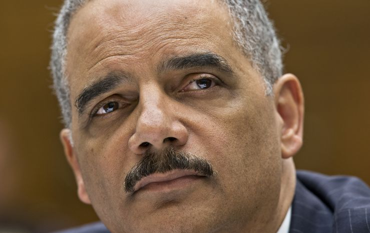 **FILE** Attorney General Eric Holder, the nation's top law enforcement official, testifies on Capitol Hill in Washington on May 15, 2013, before the House Judiciary Committee oversight hearing on the U.S. Department of Justice. (Associated Press)
