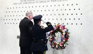Director John O. Brennan on Monday stands before 107 stars at CIA headquarters in Langley representing those who have died in service to the agency since 1947. (CIA)