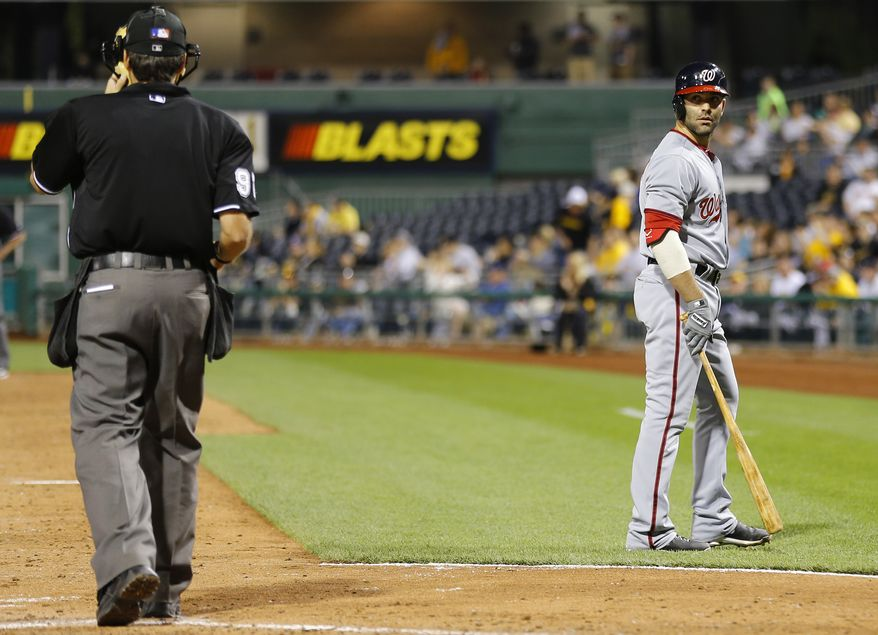 **FILE** Washington Nationals' Danny Espinosa, right, looks back at home plate umpire James Hoye after being called out on strikes to end the top of the seventh inning of the baseball game against the Pittsburgh Pirates on Friday, May 3, 2013, in Pittsburgh. (AP Photo/Keith Srakocic)