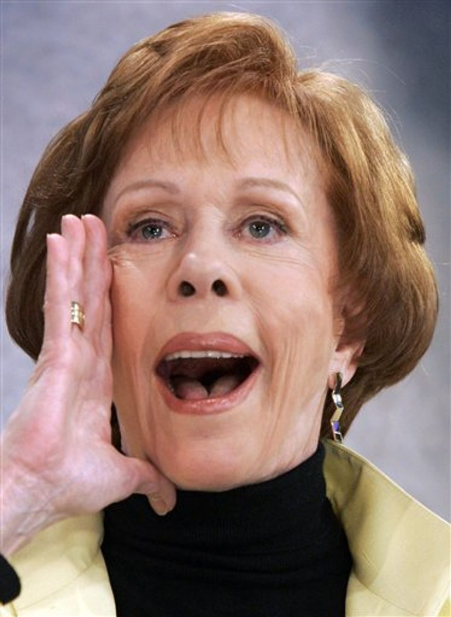 "In this 2008 photo, actress and comedienne Carol Burnett performs her famous Tarzan yell  on the ""Today"" show. The Kennedy Center for the Performing Arts announced Tuesday that Burnett will receive the Mark Twain Prize for American Humor on Oct. 20 in Washington. (AP Photo/Richard Drew, File)"