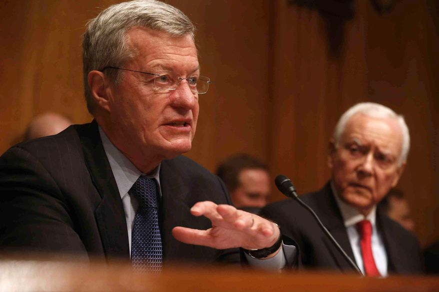 Senate Finance Committee Chairman Max Baucus (left), Montana Democrat, accompanied by Sen. Orrin Hatch of Utah, the committee's ranking Republican, questions ousted IRS Chief Steve Miller, former IRS Commissioner Douglas Shulman and J. Russell George, Treasury Inspector General for Tax Administration, on Capitol Hill on May 21, 2013, during the committee's hearing on the IRS practice of targeting applicants for tax-exempt status based on political leanings. (Associated Press)