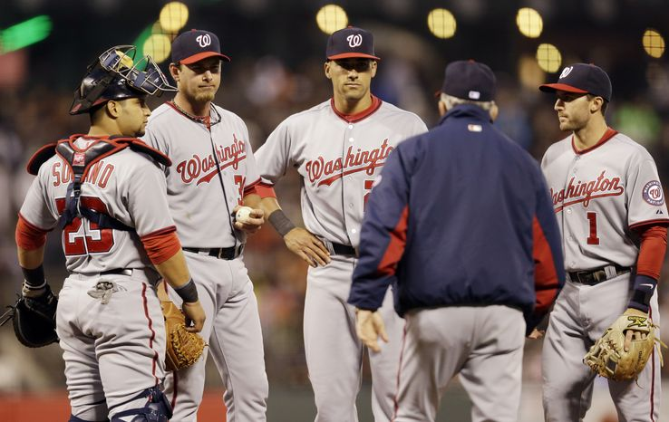 Zach Duke, second from left, lasted 3 1/3 innings in his spot start as the Nationals were pounded by the San Francisco Giants in an 8-0 loss.