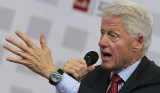 Former President Bill Clinton, honorary chancellor of Laureate International Universities, speaks during a forum to address the youth unemployment situation in Europe, at the European University of Madrid on Tuesday, May 21, 2013. (Associated Press)
