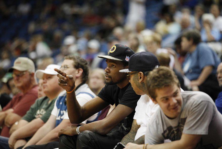 Oklahoma City Thunder forward Kevin Durant watches a play during an WNBA preseason basketball game between the Minnesota Lynx and Connecticut Sun, Tuesday, May 21, 2013, in Minneapolis. The Sun won 80-88. The Oklahoma City Thunder are giving $1 million for tornado relief, matching a $1 million pledge by star player Durant. The Thunder announced Tuesday that they'll give $1 million to the American Red Cross, the Salvation Army and other disaster relief organizations helping after Monday's disaster in suburban Oklahoma City. (AP Photo/Stacy Bengs)