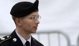 Army Pfc. Bradley Manning is escorted into a courthouse in Fort Meade, Md., Tuesday, May 21, 2013, before a pretrial military hearing. Manning, who is scheduled to face a court martial beginning June 3, is accused of sending hundreds of thousands of classified records to WikiLeaks while working as an intelligence analyst in Baghdad. (AP Photo/Patrick Semansky)
