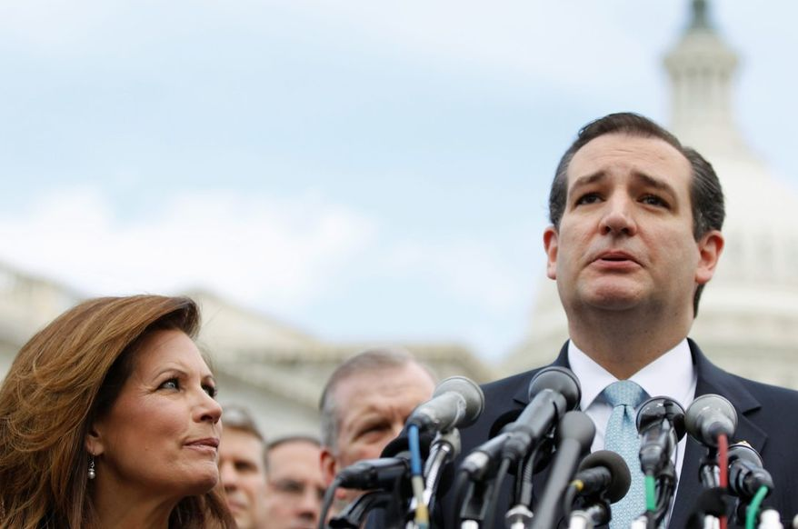 ** FILE ** Sen. Ted Cruz, R-Texas, accompanied by Rep. Michele Bachmann, R-Minn., chair of the tea party caucus, speaks during a news conference with tea party leaders about the IRS targeting tea party groups, Thursday, May 16, 2013, on Capitol Hill in Washington. (AP Photo/Molly Riley)