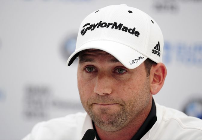 """Spain's Sergio Garcia at a Press Conference during the PRO/AM tournament at the Wentworth Club, Surrey, England, Wednesday May 22, 2013. Tiger Woods says the """"fried chicken"""" comment from Sergio Garcia was hurtful and inappropriate. Two weeks after they verbally sparred at The Players Championship, Woods say it's time to move on. Garcia was at a European Tour awards dinner Tuesday night when he was jokingly asked if he would have Woods over for dinner during the U.S. Open. The Spaniard replied, """"We'll have him round every night. We will serve fried chicken."""" (AP Photo/Adam Davy/PA )"""