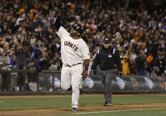 Giants third baseman Pablo Sandoval celebrated a 464-foot walk-off home run to beat the Nationals, 4-2, on Tuesday night. (Associated Press photo)