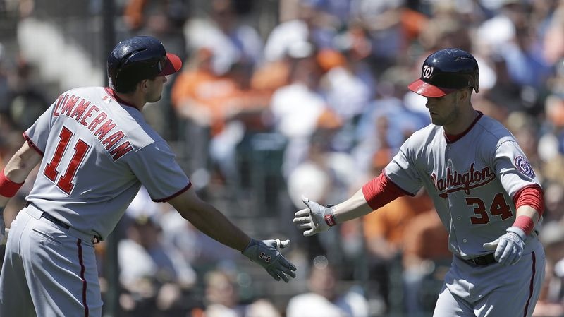 Washington Nationals Ryan Zimmerman (11) congratulates Bryce Harper, right, after Harper hit a home run off San Francisco Giants' Madison Bumgarner in the sixth inning of a baseball game on Wednesday, May 22, 2013, in San Francisco. (AP Photo/Ben Margot)