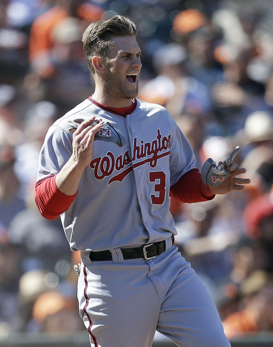 Washington Nationals' Bryce Harper celebrates after scoring against the San Francisco Giants in the 10th inning of a baseball game Wednesday, May 22, 2013, in San Francisco. Harper scored on a hit by Nationals' Ian Desmond. (AP Photo/Ben Margot)
