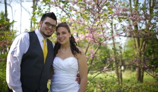 Jordan Costa and his wife, Heather Favazza-Costa, pose May 18, 2013, for a photo at their wedding at Connection Church in Canton Township, Mich. The 21-year-old groom was killed and his wife sustained minor injuries when their vehicle crashed in Ohio's Tuscarawas County the next day. The newlyweds were on the way to their honeymoon in Myrtle Beach, S.C. (Associated Press/Connection Church)