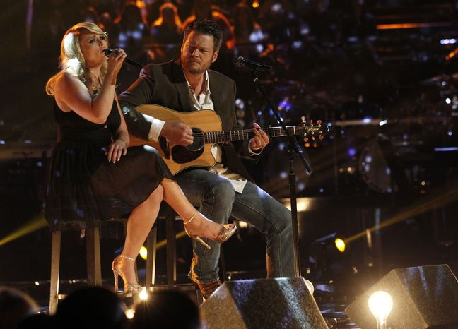 "Husband-and-wife singers Blake Shelton (right) and Miranda Lambert perform an acoustic version of the hit ""Over You"" during a broadcast of the singing competition series ""The Voice"" in Los Angeles on Tuesday, May 21, 2013. Mr. Shelton, an Oklahoma native, and NBC are putting together a benefit for tornado victims in his home state. (AP Photo/NBC, Trae Patton)"
