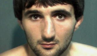 ** FILE ** In this May 4, 2013, police mug provided by the Orange County Corrections Department in Orlando, Fla., shows Ibragim Todashev after his arrest for aggravated battery in Orlando. Todashev, who was being questioned in Orlando by authorities in the Boston bombing probe, was fatally shot Wednesday, May 22, 2013, when he initiated a violent confrontation, FBI officials said. (AP Photo/Orange County Corrections Department)