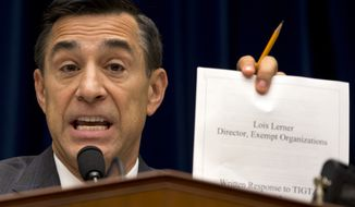 Rep. Darrell E. Issa, California Republican and House Oversight Committee chairman, holds up a document as he speaks to IRS official Lois Lerner on Capitol Hill in Washington on Wednesday, May 22, 2013, during the committee's hearing to investigate the extra scrutiny IRS gave to tea party and other conservative groups that applied for tax-exempt status. Ms. Lerner told the committee she did nothing wrong and then invoked her constitutional right to not answer lawmakers' questions. (Associated Press)
