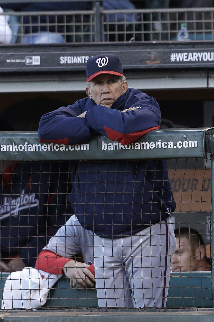 Washington Nationals manager Davey Johnson watches from the dugout during the first inning of a baseball game against the San Francisco Giants in San Francisco, Tuesday, May 21, 2013. (AP Photo/Jeff Chiu)